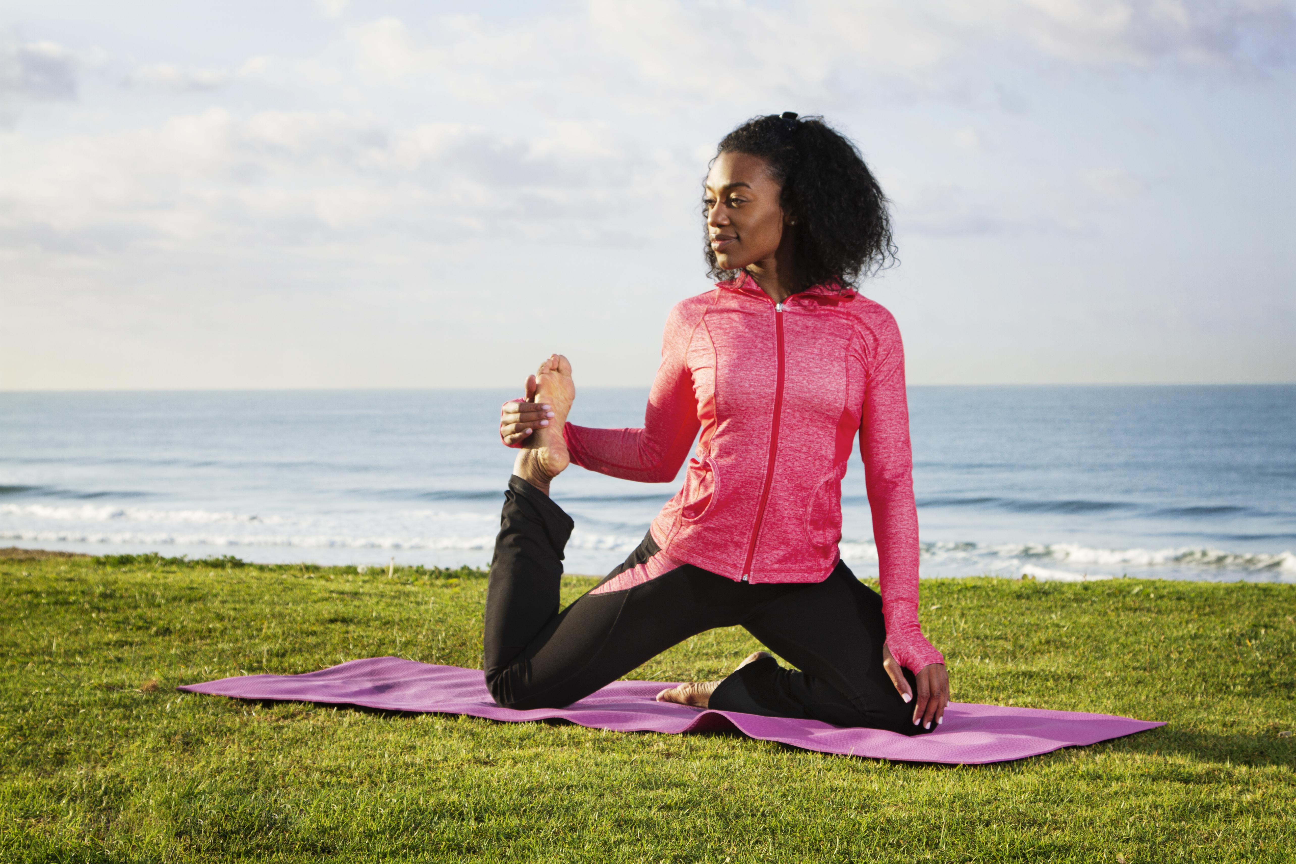 Woman Doing Yoga On The Coast