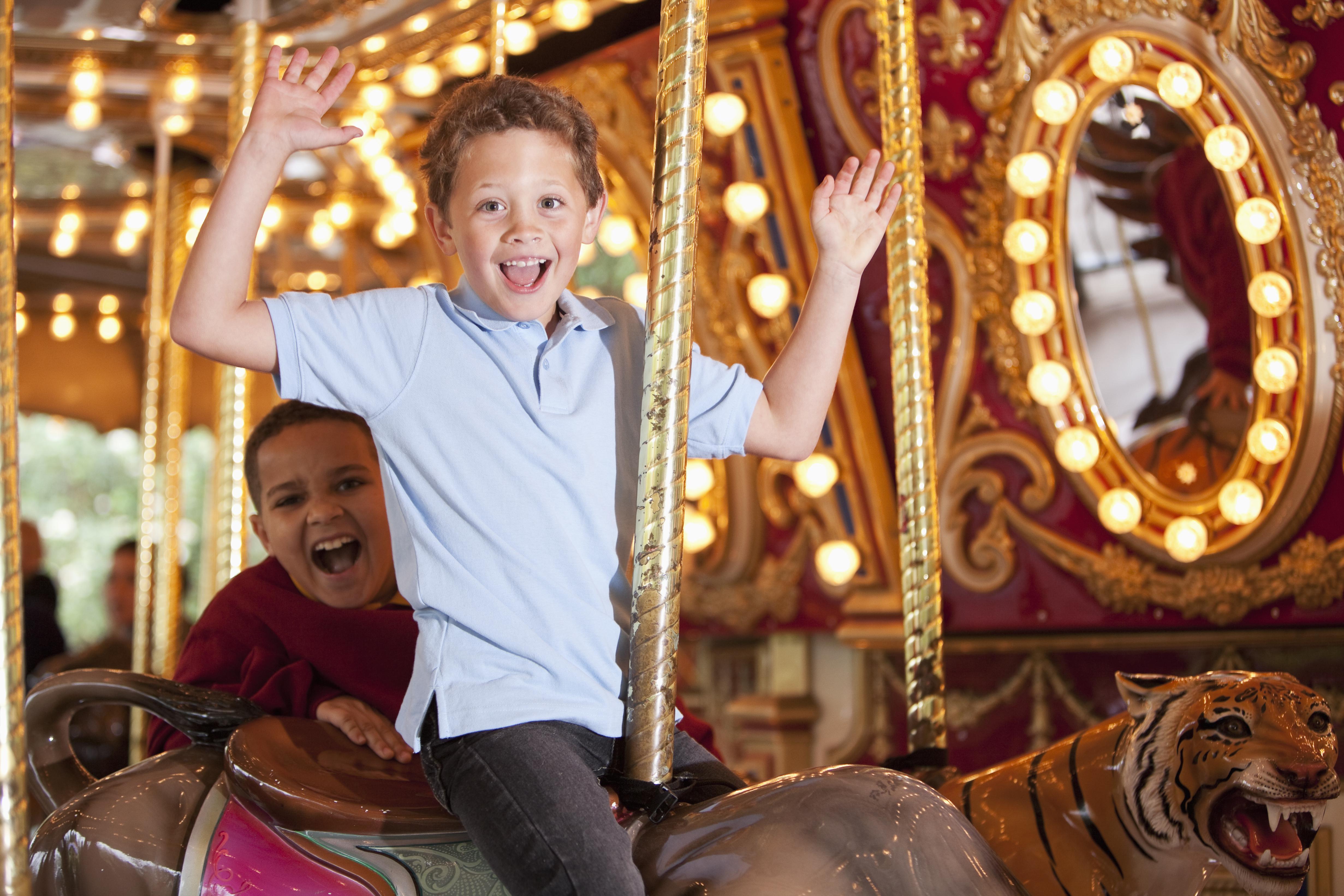 Boys riding carousel