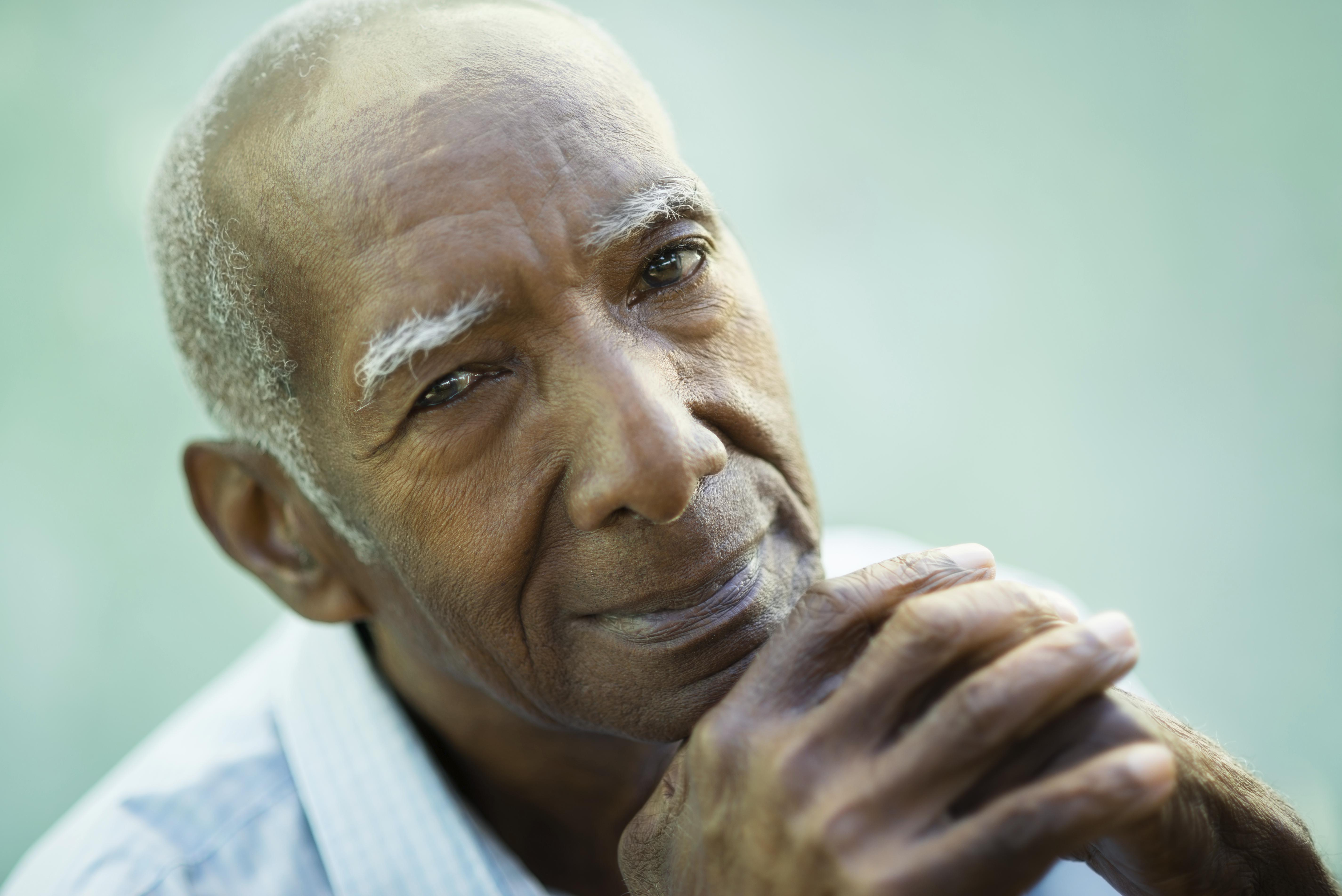 Portrait of happy senior hispanic man looking at camera and smiling. Close-up of face, copy space