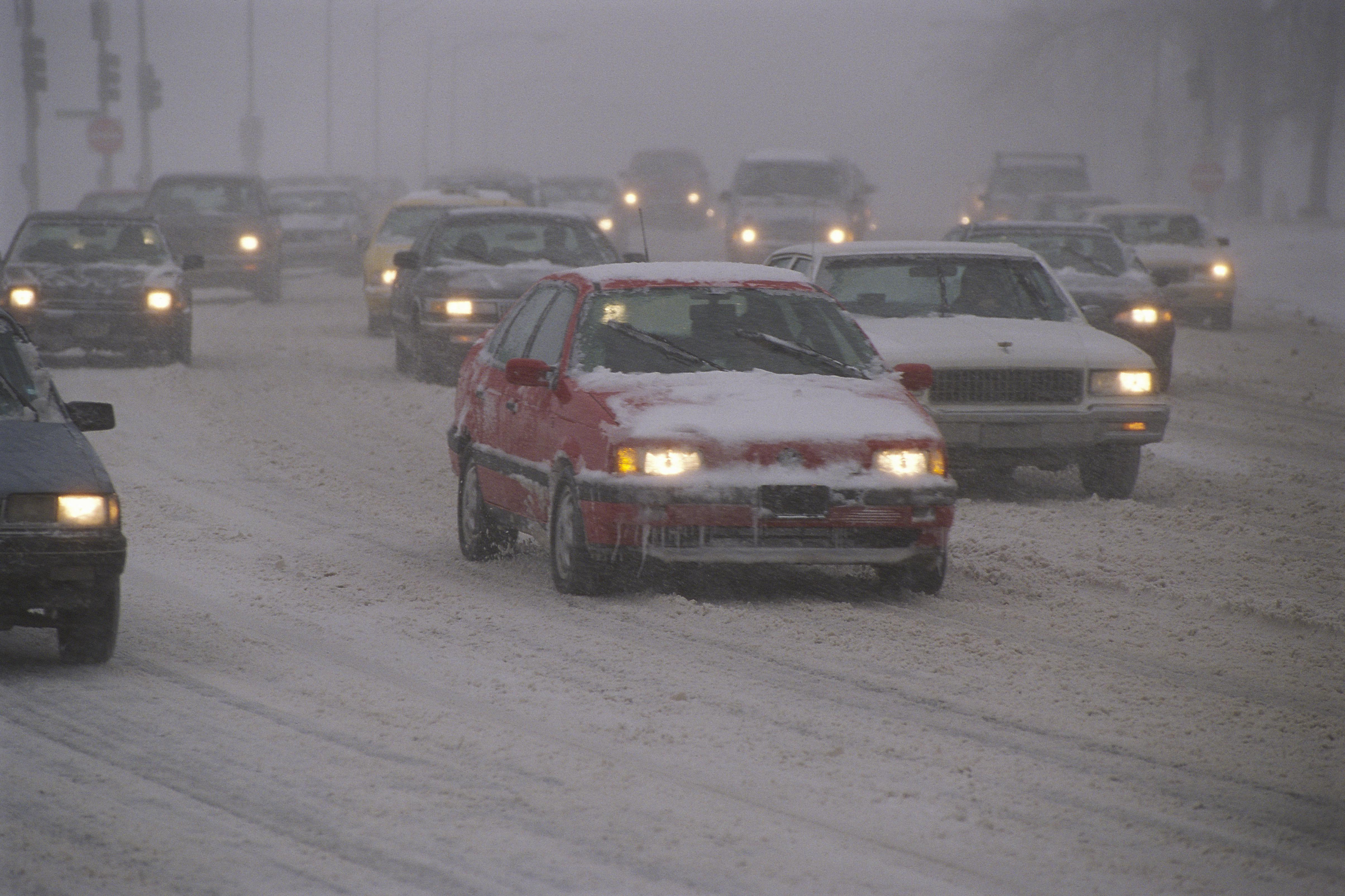 Traffic driving in snowstorm