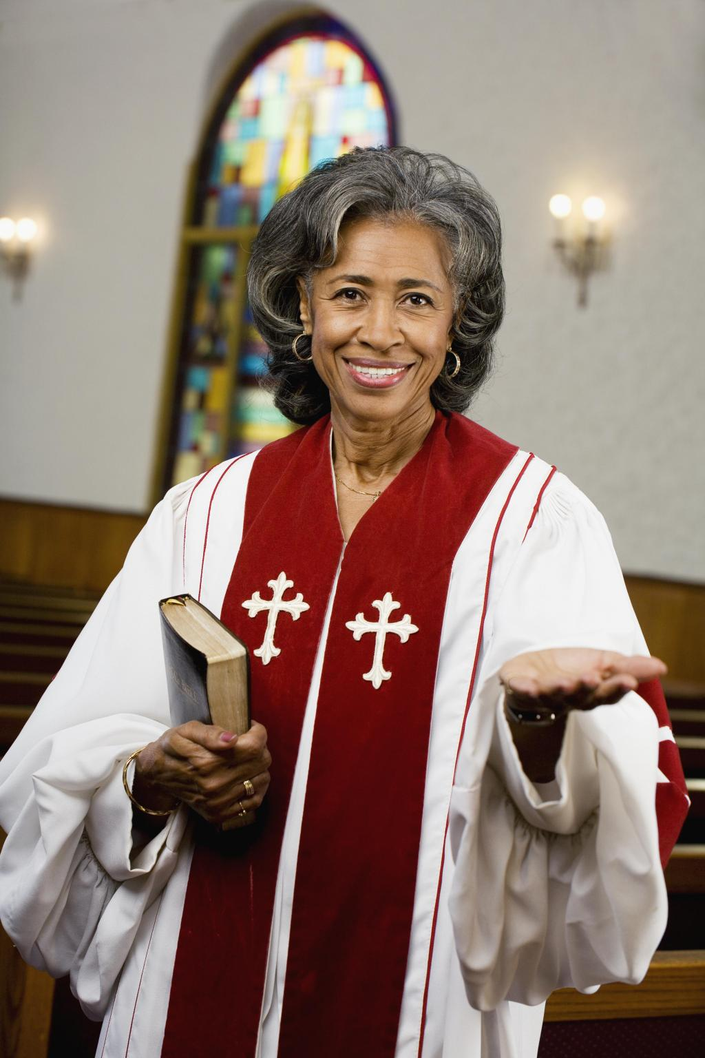 African American female Reverend holding Bible
