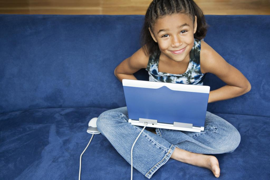 African American girl working on lap top computer