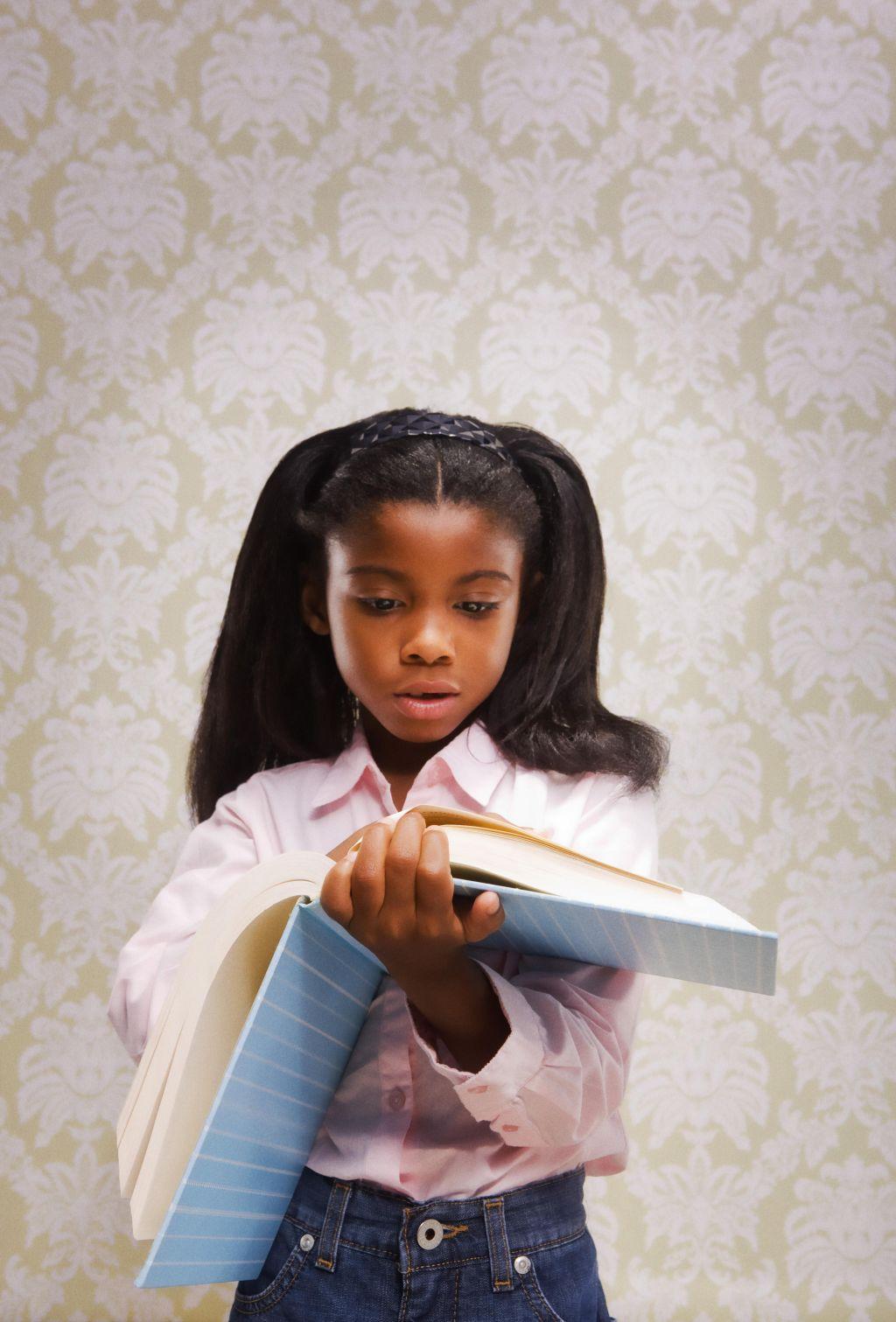 Girl thumbing through book