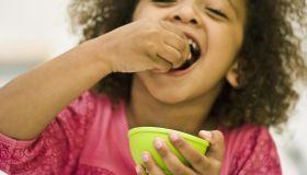 Little girl eating snack