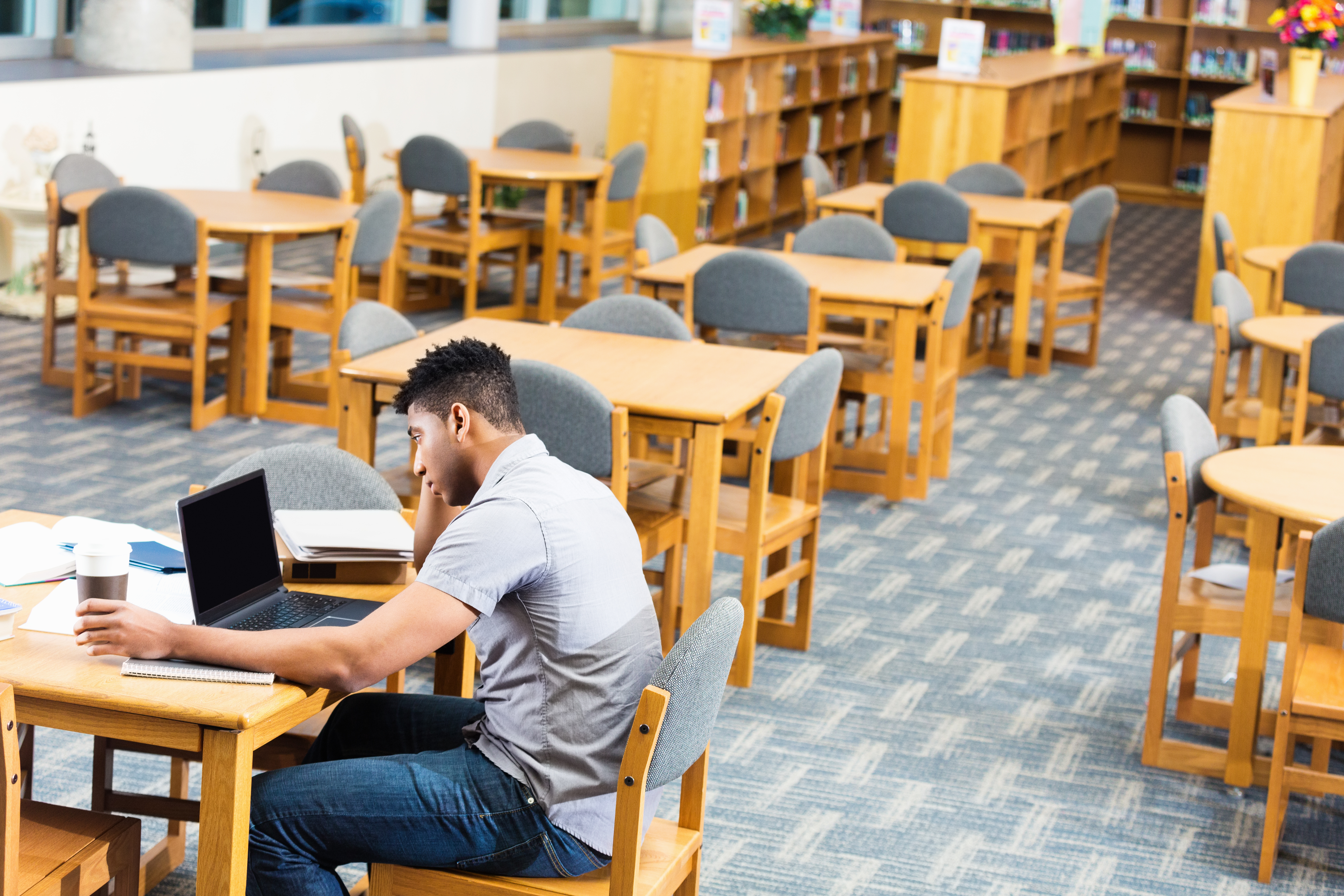 African American high school or college student studying late