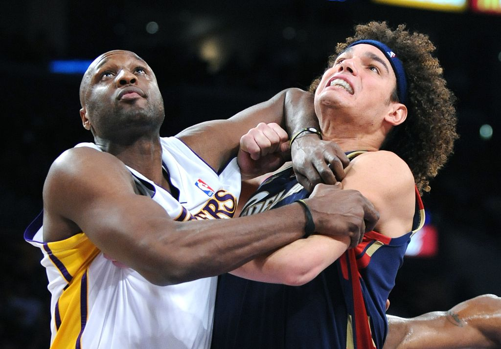 Lakers Lamar Odom grabs Cavaliers Anderson Varejo while batling for position under the basket at th