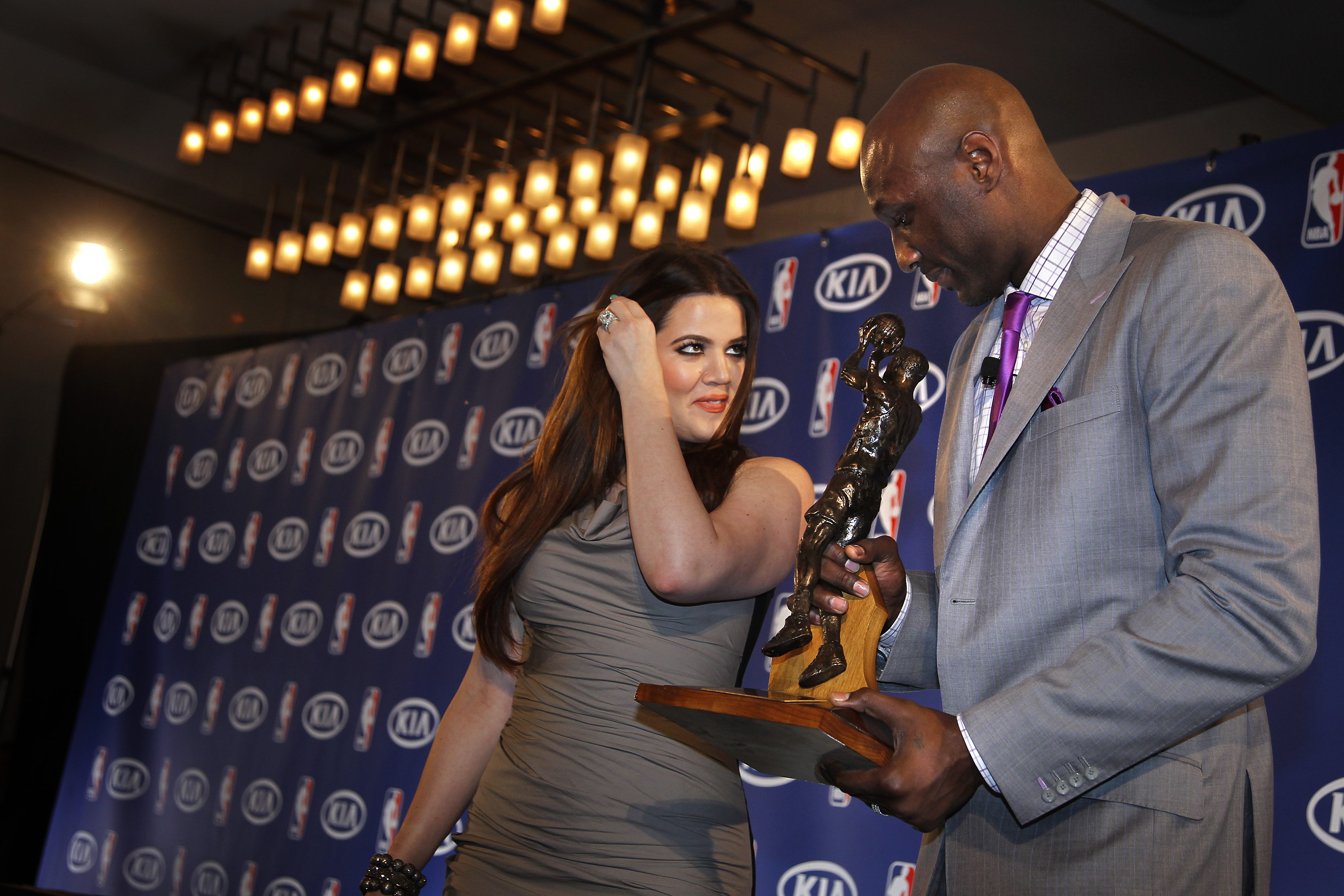 Khloe Kardashian watches her husband, Lamar Odom, a forward for the Los Angeles Lakers, who receive