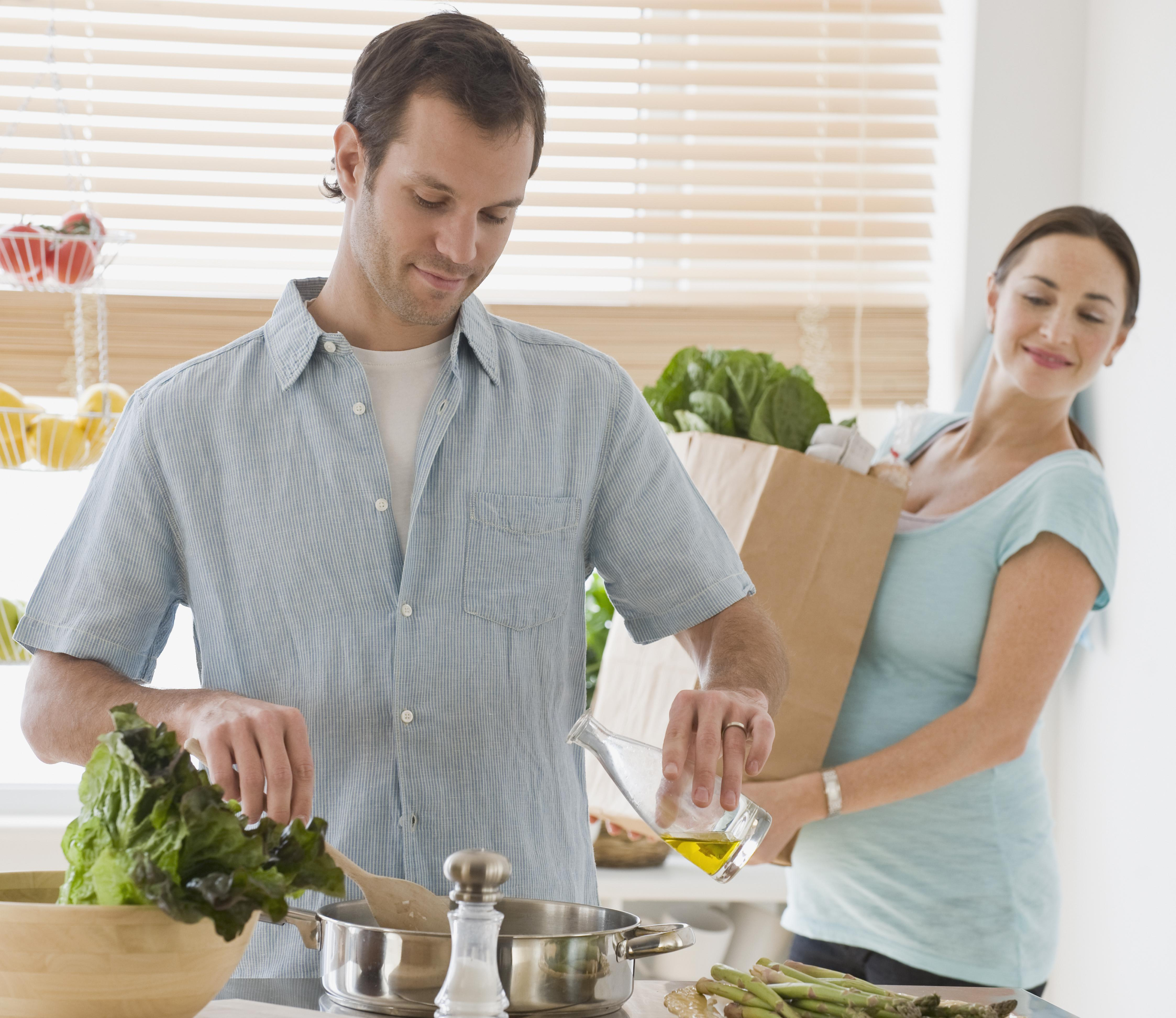 Hispanic couple preparing food