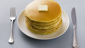 Stack of pancakes with butter on a plate