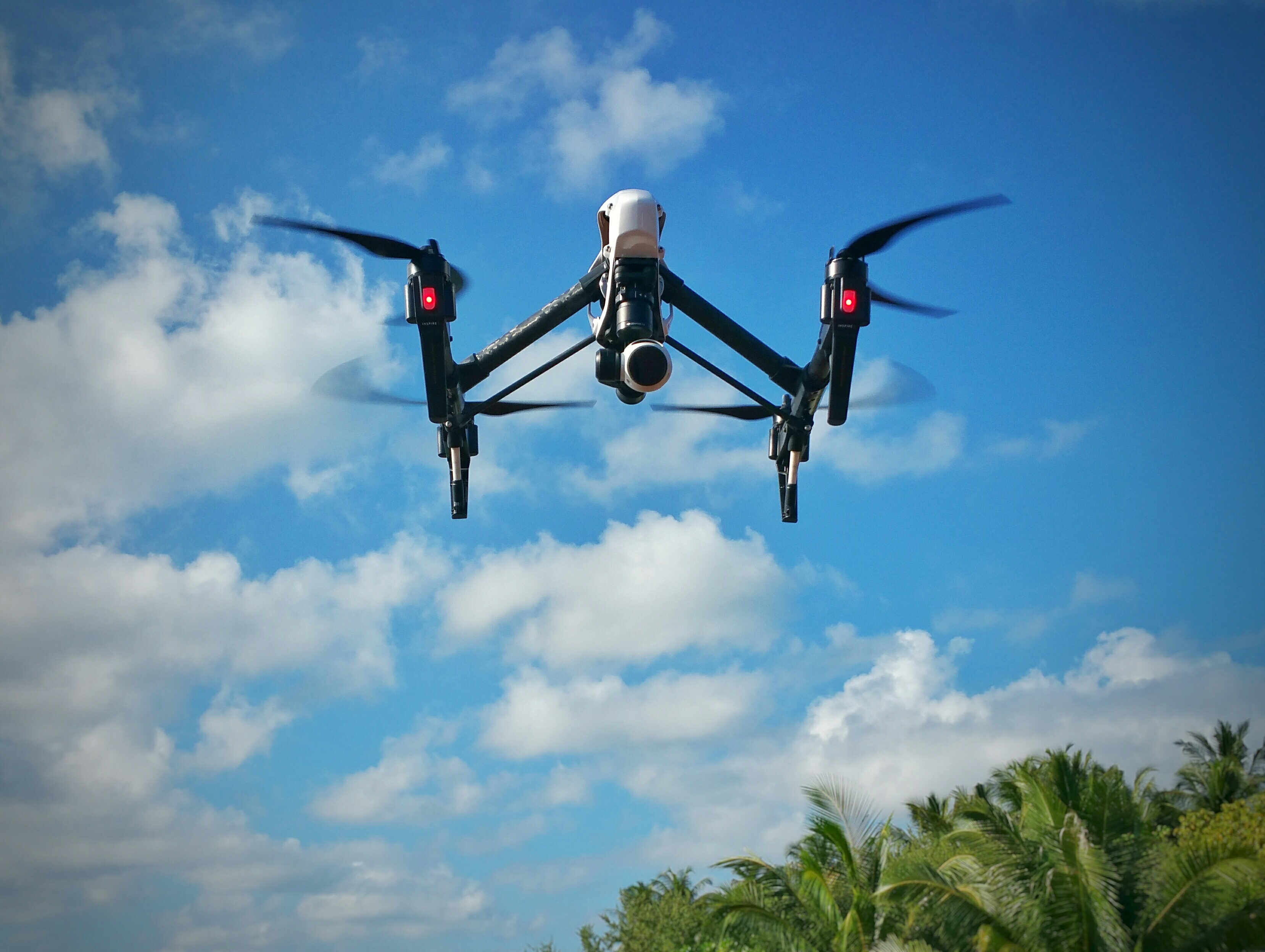 Drone With Camera Against Sky