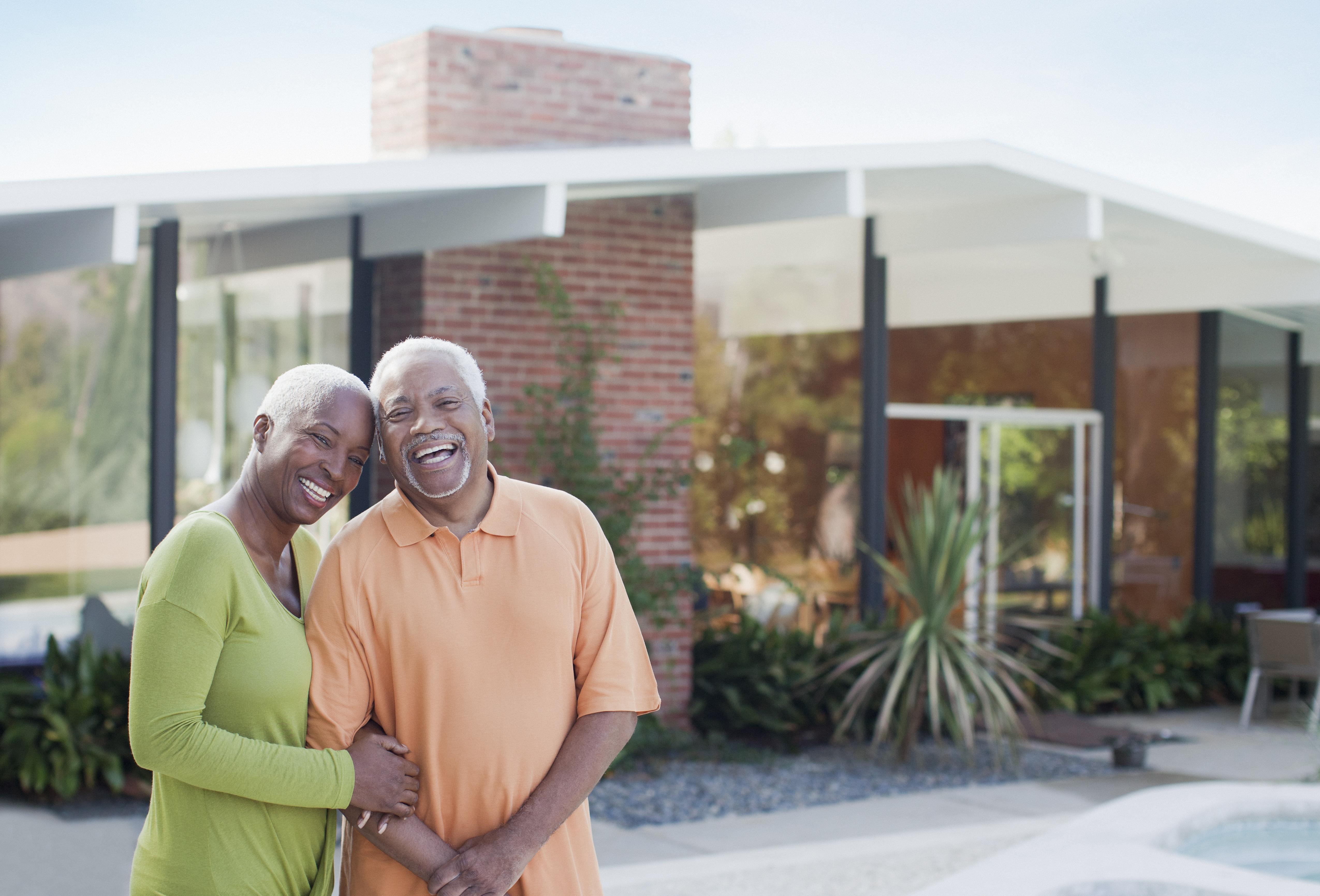 Older couple smiling in backyard