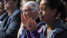 Malia Obama applauds as her father US Pr