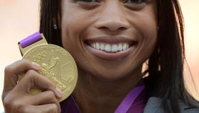 US' gold medalist Allyson Felix poses on
