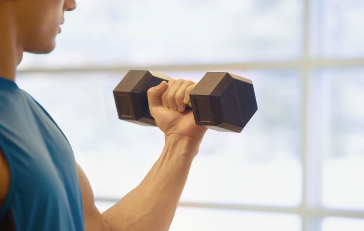 Asian man lifting weights