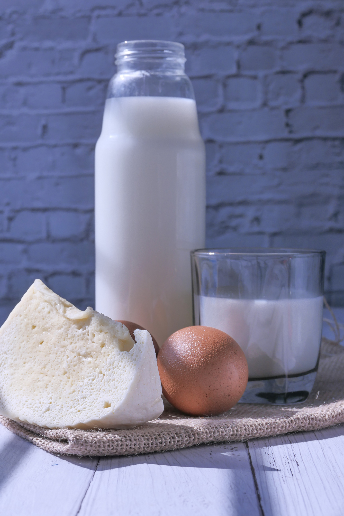 milk, cheese and egg on table