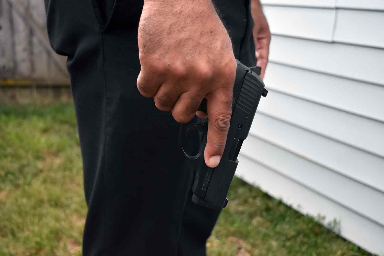 Police Officer holding handgun pistol