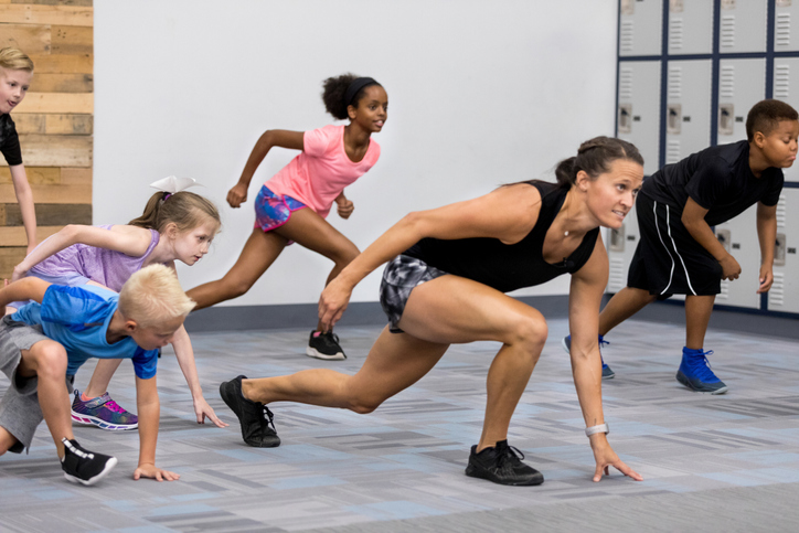 Group of children participate in fitness class