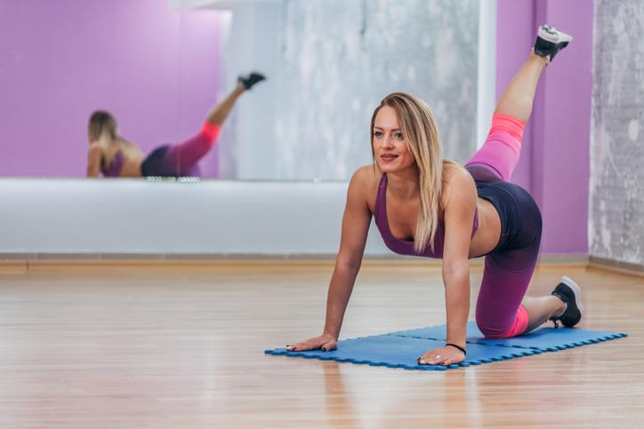 Woman using mat for exercising