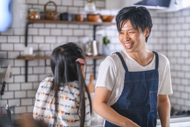 Japanese Father and Young Daughter Bonding in Kitchen