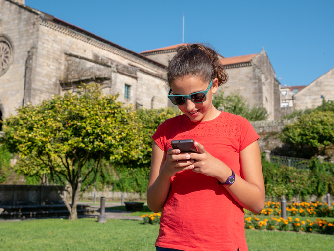 Young girl checking her smartphone