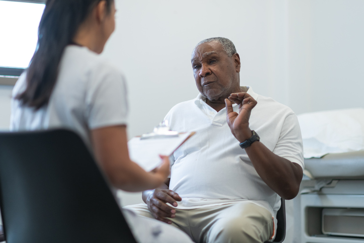 Senior adult man in consultation with female doctor
