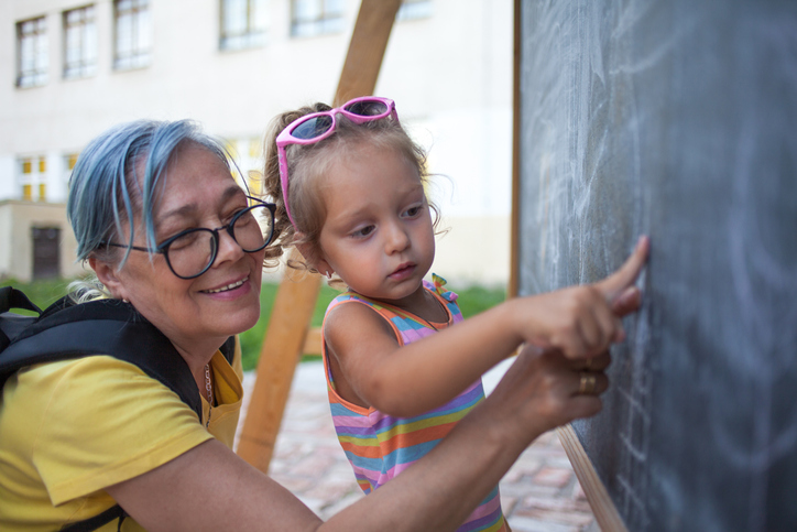 Grandma and granddaughter learning together