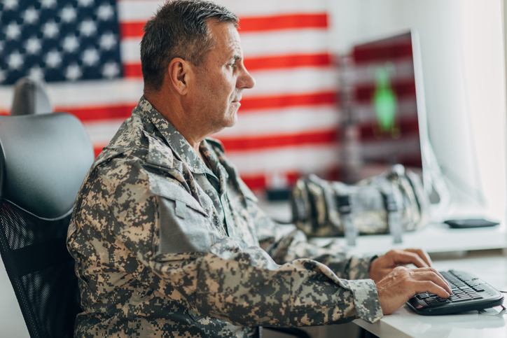 Army soldier using computer