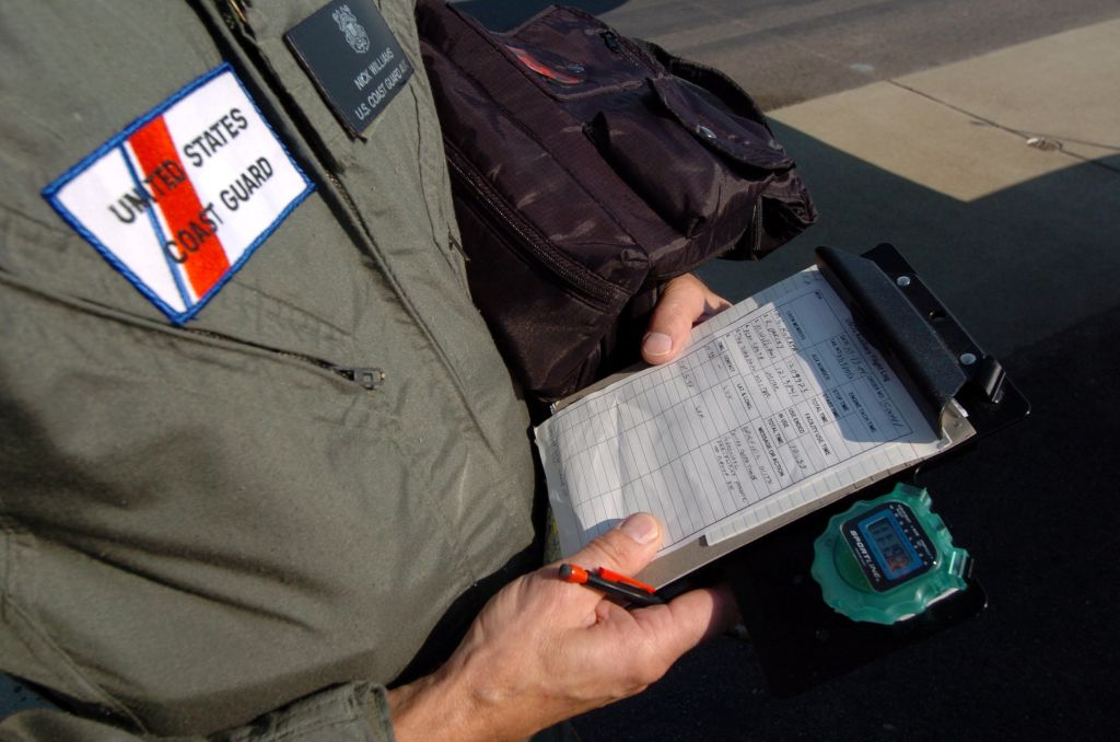 Coast Guard Auxiliary observer Nick Williams looks over his flight log prior to a mission over the Northern California coast Wednesday Oct 13, 2004. Williams and two other members of the Coast Guard Auxiliary flew a four hour coastal mission out of Liverm