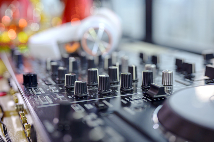 DJ mixer or sound equipment at nightclubs and music festivals.