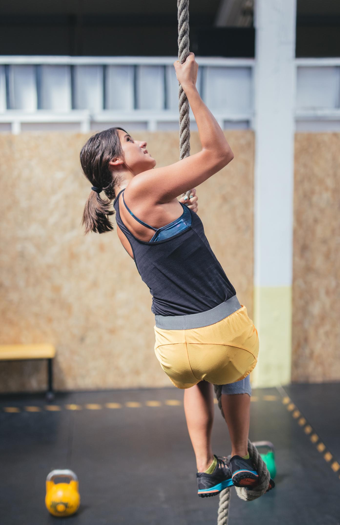 Woman climbing rope