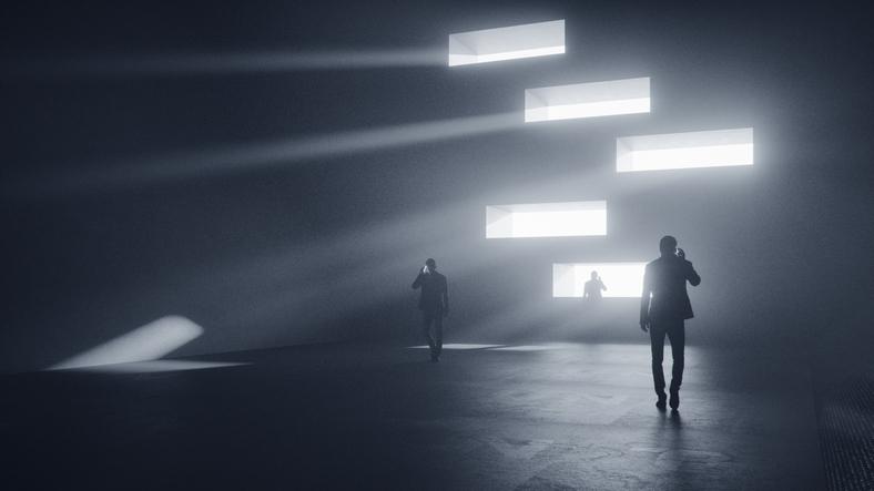 Men on the phone walking in dark, futuristic street