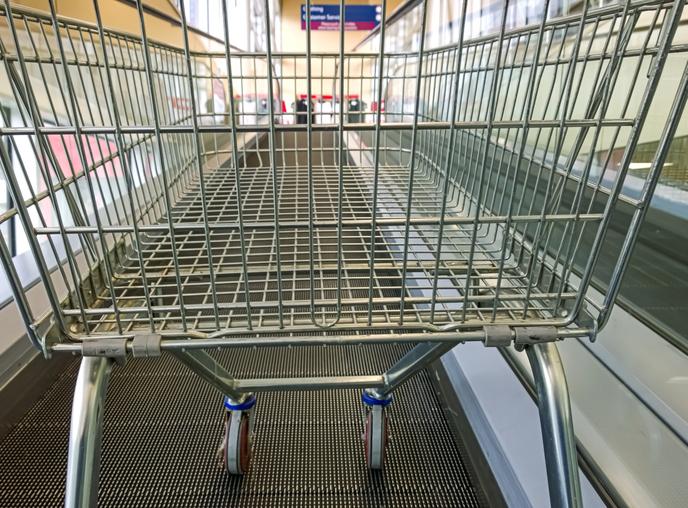 Empty shopping cart on shopping trolley escalator