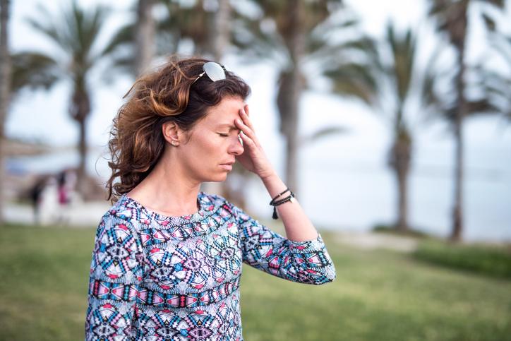 Mature woman having a strong headache.