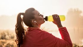 Young woman Refreshing after running