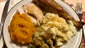 Turkey dinner with mashed potatoes, squash, stuffing, and gravy