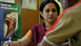 An HIV-positive patient (R) consults a d