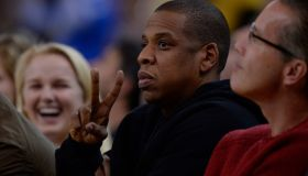 Rapper Jay-Z gestures while sitting court side as the Golden State Warriors play the San Antonio Spurs in the second quarter of their game at Oracle Arena in Oakland, Calif., on Monday, Jan. 25, 2016. (Jose Carlos Fajardo/Bay Area News Group)