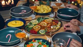 Christmas Dinner with Salmon Fish Fillet, Vegetables, Polenta and Christmas Cake