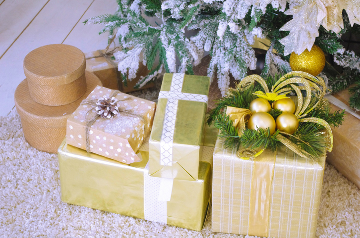 Close-Up Of Christmas Presents By Tree On Floor