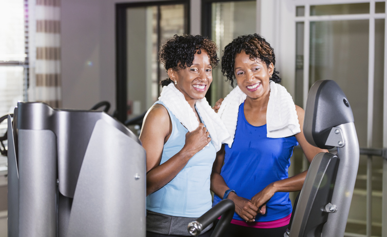 Identical twins after working out at the gym