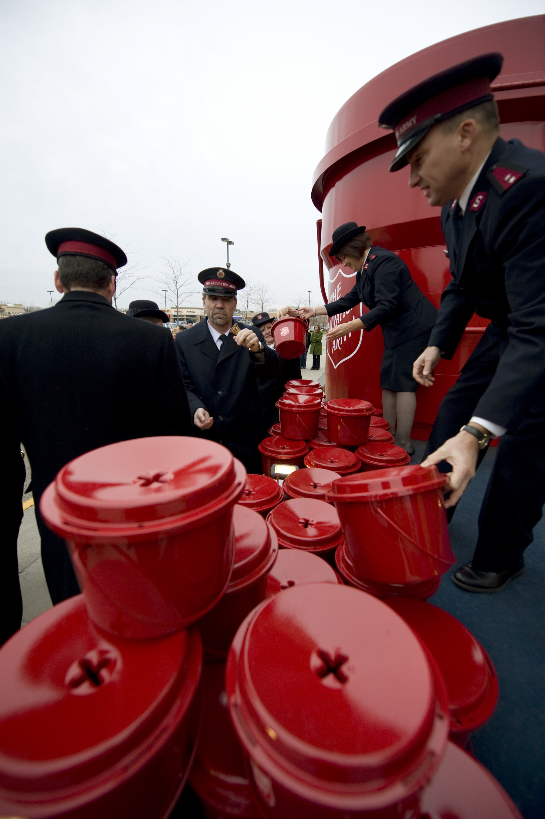 DAVID BREWSTER • dbrewster@startribune.com Thursday_11/12/09_St.Anthony ] The Salvation Army handed out the red kettles and hand bells at a kick-off ceremony for its annual holiday fund raiser.