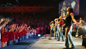 The crowd waves their arms in unison at the Panetshakers meeting at Hillsong Chu