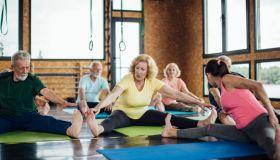 Seniors stretching on the yoga class