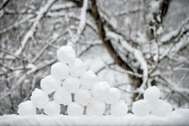 Ready for battle. Freshly made pyramid of snowballs