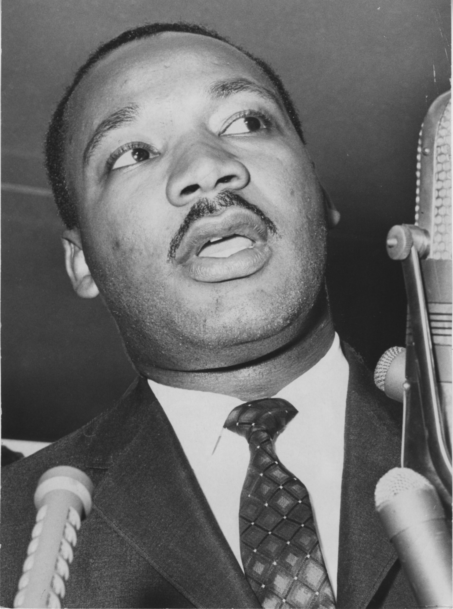 San Francisco, CA July 4, 1964 - Dr. Martin Luther King Jr. meets the press at San Francisco Airport.(Jim Edelen / Oakland Tribune)