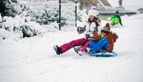 Children sledding in winter.