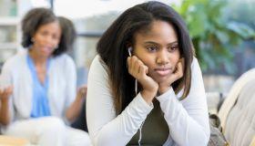 Rude teenage girl ignores her mom