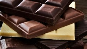 Chocolate bars in rustic wooden table