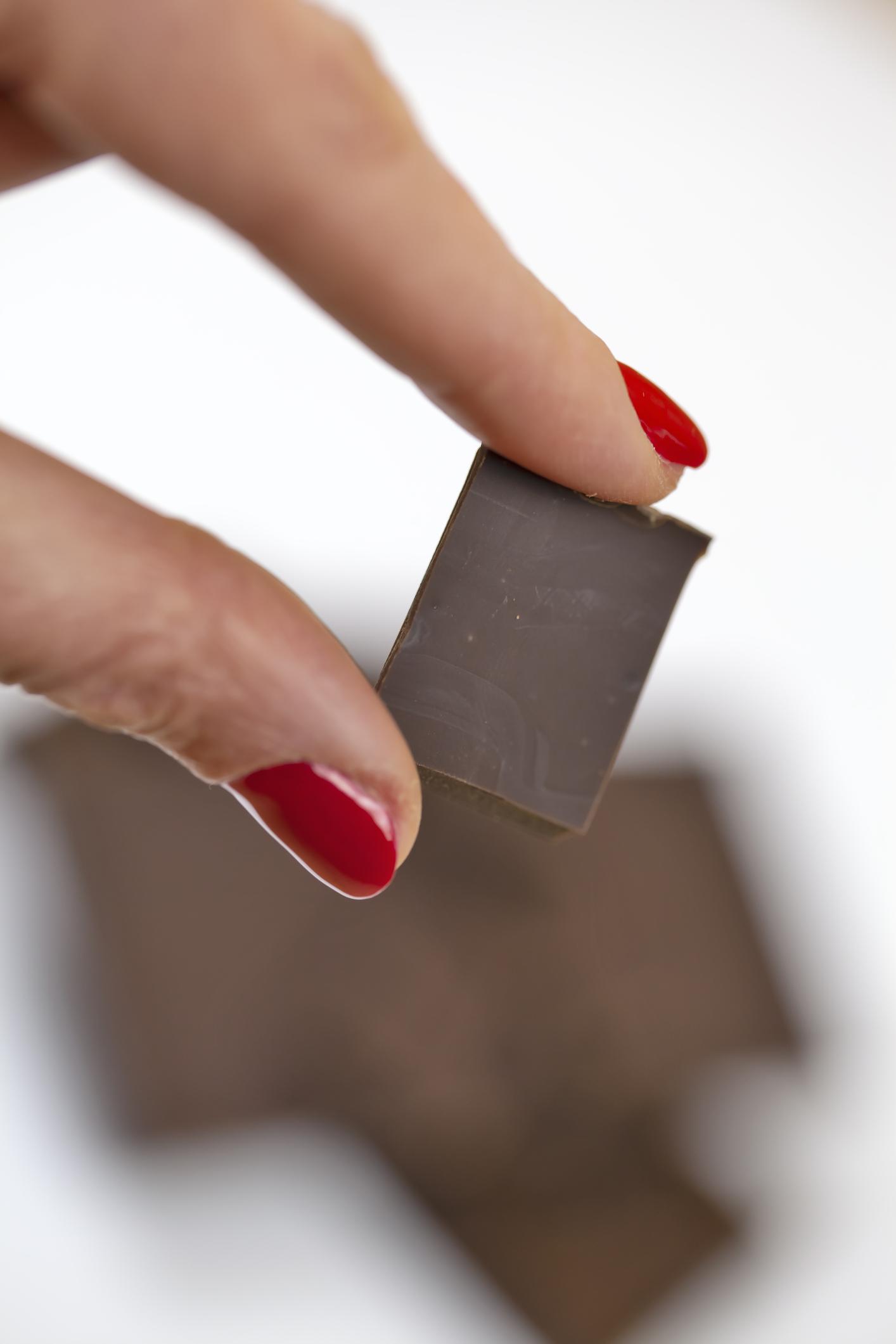Woman holding chocolate chunks