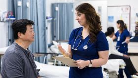 Serious female doctor talks with patient